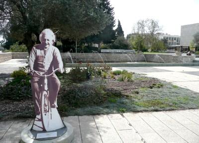Einstein riding a bike at the Edmond J. Safra campus